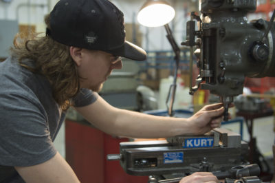 BEX technician maintains industrial manufacturing machinery
